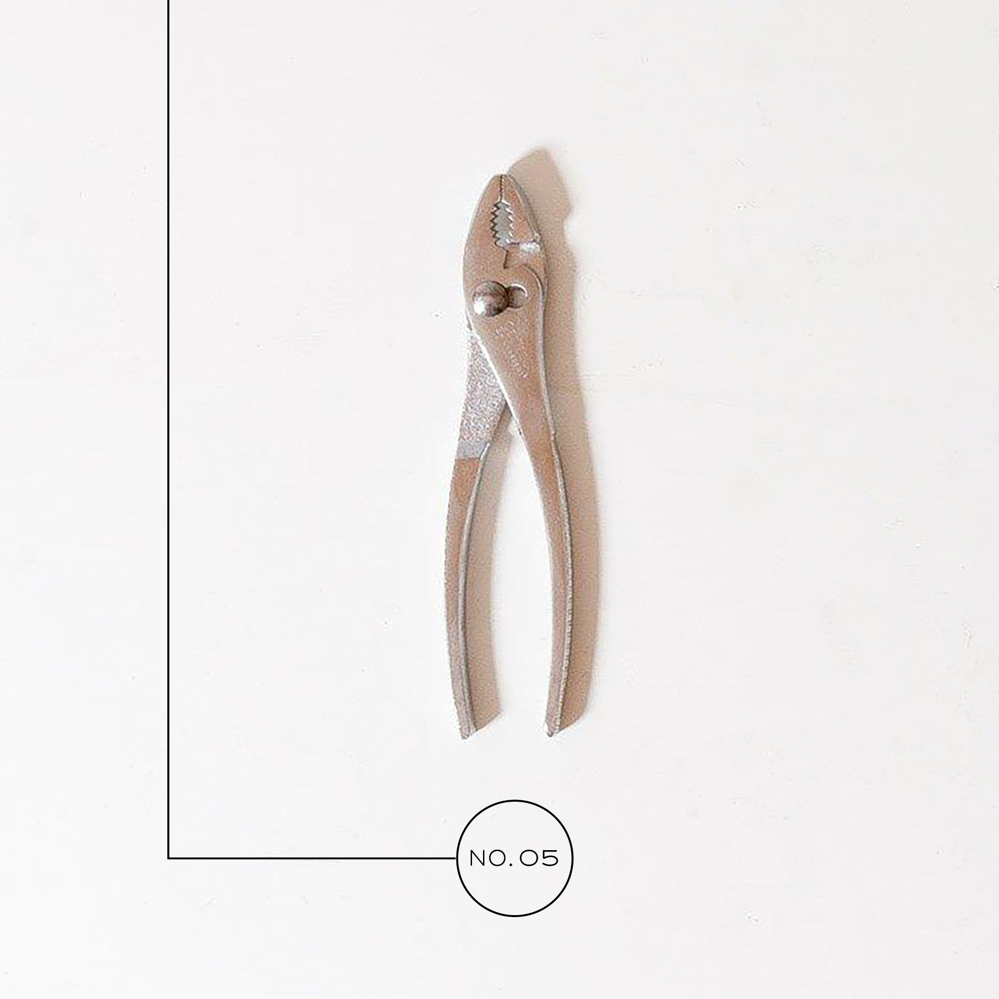 A photo of pliers on a white background.